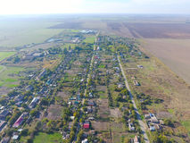 Top view of the village. One can see the roofs of the houses and gardens. Road in the village. Village bird's-eye view Stock Images