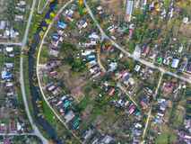 Top view of the village. One can see the roofs of the houses and gardens. Road and water in the village. Village bird's-eye view Royalty Free Stock Image
