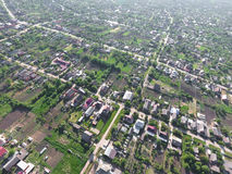 Top view of the village. One can see the roofs of the houses and gardens. Road and water in the village. Village bird's-eye view Royalty Free Stock Photos