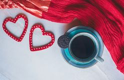 Cup of coffee, hearts decorations and a red scarf on white background stock photo