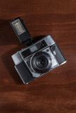 Top view of a vintage camera with flash. On wooden surface Stock Images