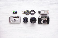 Top view of vintage cameras on a white wooden background Stock Image