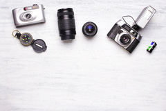 Top view of vintage cameras on a white wooden background Royalty Free Stock Photos