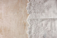 Top view of vintage hand made beautiful lace fabric over wooden table.  royalty free stock photography