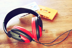 Top view of vintage headphones and cassettes Stock Photos
