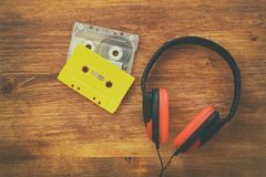 Top view of vintage headphones and cassettes Royalty Free Stock Images
