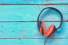 Top view of vintage headphones over aqua wooden table. retro filtered Stock Photography