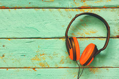 Top view of vintage headphones over aqua wooden table. retro filtered Royalty Free Stock Photography