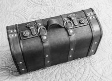 Top view of vintage leather suitcase in black and white, standin Stock Image