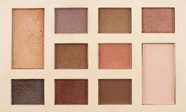 Top view of vintage makeup kit. Top view of makeup kit with vintage colors and nuances Stock Photo