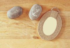 Top view of vintage nautical frame from ropes on wooden table.  Stock Photos