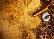 Old vintage navigation equipment on old world map. stock image