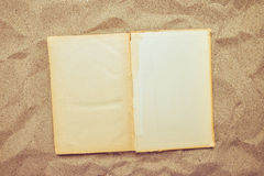 Top view of vintage open book on sandy beach Stock Photography