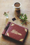 Top view of vintage photo album and coffee on table Royalty Free Stock Photography