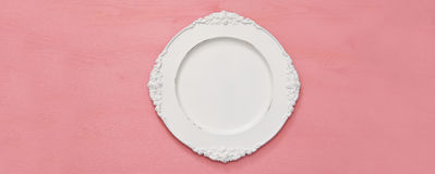 Top view of vintage white empty plate. Flat lay Stock Image