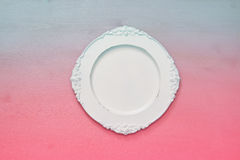 Top view of vintage white empty plate. Flat lay Royalty Free Stock Photos