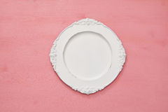 Top view of vintage white empty plate. Flat lay Royalty Free Stock Image