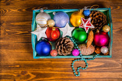Top view of vintage wooden box with Christmas decoration, tinsel Royalty Free Stock Photography
