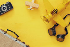 Top view of vintage yellow toy plane, old photo camera Royalty Free Stock Images