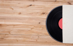 Top view of vinyl record over wooden table. Royalty Free Stock Photo