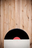 Top view of vinyl record over wooden table. Royalty Free Stock Photography