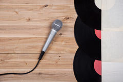 Top view of vinyl record over wooden table and microphone Stock Photography