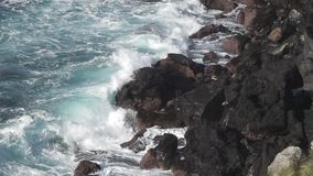 Volcanic coastline and waves breaking in super slow motion stock video footage