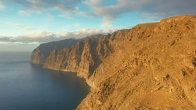 Top view of volcanic mountains in the ocean stock video footage