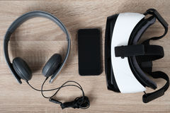 Top view VR virtual reality glasses, headphones and  smart phone Stock Photo