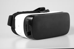 Top view VR virtual reality glasses  on white background. Top view VR virtual reality glasses half turned isolated on white background Royalty Free Stock Photo