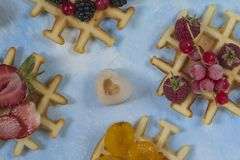 Waffles. Top view of waffles decorated with berries Royalty Free Stock Images