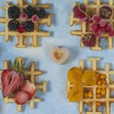 Waffles. Top view of waffles decorated with berries Royalty Free Stock Photos