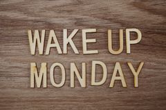 Wake Up Monday text message on wooden background. Top view of Wake Up Monday text message on wooden background royalty free stock images