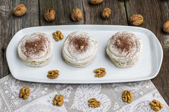 Top View on Walnuts Meringues with cocoa with cracking walnuts Royalty Free Stock Photo