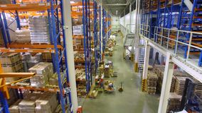 A top view on a warehouse building with racks and loading area. stock video