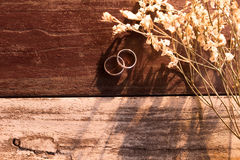 Top view and warm tone. two silver ring put beside white bouquet Royalty Free Stock Photo