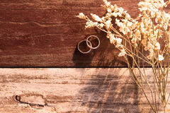 Top view and warm tone. two silver ring put beside white bouquet Royalty Free Stock Photography
