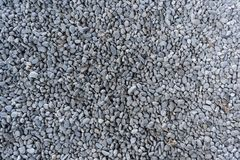 Top view on washed gravel in blue gray, size 10-12 mm, laid out on the ground royalty free stock photo