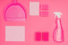 Top view of washing sponges, scoop and spray bottle. Isolated on pink royalty free stock photography