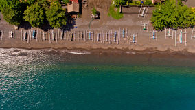 Top view of the water coast line with stony beach with boats. Village of Amed, Bali, Indonesia royalty free stock image