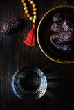 Top view of water for iftar, islamic rosary and ramadan dates. Royalty Free Stock Images