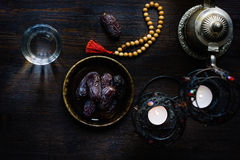 Top view of water for iftar, islamic rosary and ramadan dates. stock images