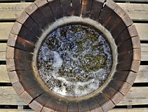 Wooden water well with bubbling water, national nature reserve S. Top view on water well made by wooden planks with bubbling water inside, national nature Stock Photography