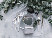 Top view wedding rustic table with eucalyptus. Tableware Royalty Free Stock Photography