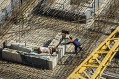 Top view of a welder at a construction site. Produces welding works and working hard Royalty Free Stock Photos