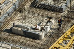 Top view of a welder at a construction site. Produces welding works and working hard Stock Images