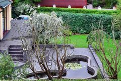 Top View On Well Cared Backyard With Patio And Pond Royalty Free Stock Photography