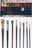 Well ordered paintbrushes and watercolour paints at designer workplace Stock Photography
