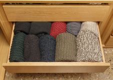 A well-organized drawer open. Top view of a well-organized closet drawer open with great storage system. Wardrobe order royalty free stock images