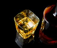 Top of view of whiskey with ice in glass on black background Stock Photos